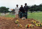 the grave and Raymond's mother, brother and sister