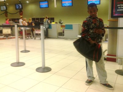 Liyema at airport on the way to Namibia