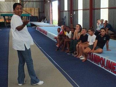 head of department speaking to gymnasts